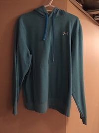 green and white Under Armour pullover hoodie