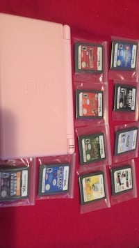 white nintendo ds with cartridges New York, 10467