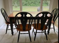 Four brown wooden windsor chairs Aurora