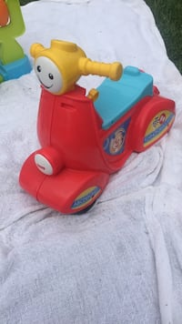 toddler's red and blue ride-on toy 238 mi