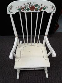 white wooden rocking chair with white pad Laval