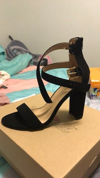 Pair of black open-toe ankle strap heels 1695 mi