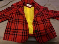 red and black houndstooth print jacket