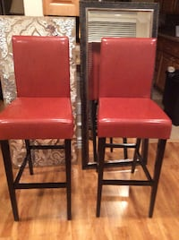 two red leather padded chairs