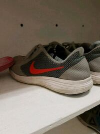 pair of gray-and-red Nike running shoes Hamilton