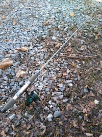 Two fishing poles and tackle box