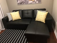 Faux leather sectional sofa-bed with storage Bolton, L7E 2W2
