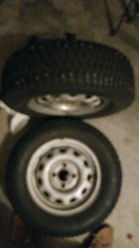 two gray 4-lugs car-wheels with tire