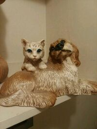 two white-and-brown cat n dog ceramic figurines 69 km