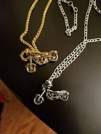 silver-colored chain necklace with cross pendant