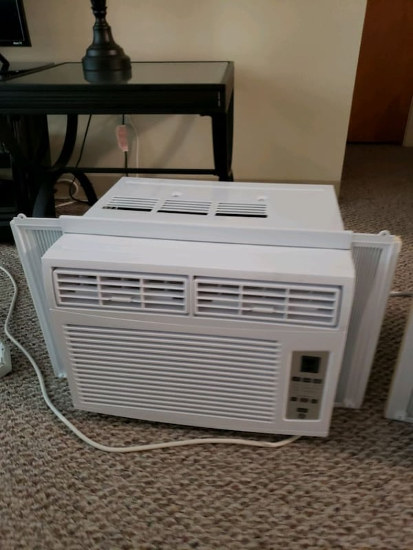 Two GE window unit Air Cinditioners fb5590e8-52d6-4319-b2eb-a35a740c03a9