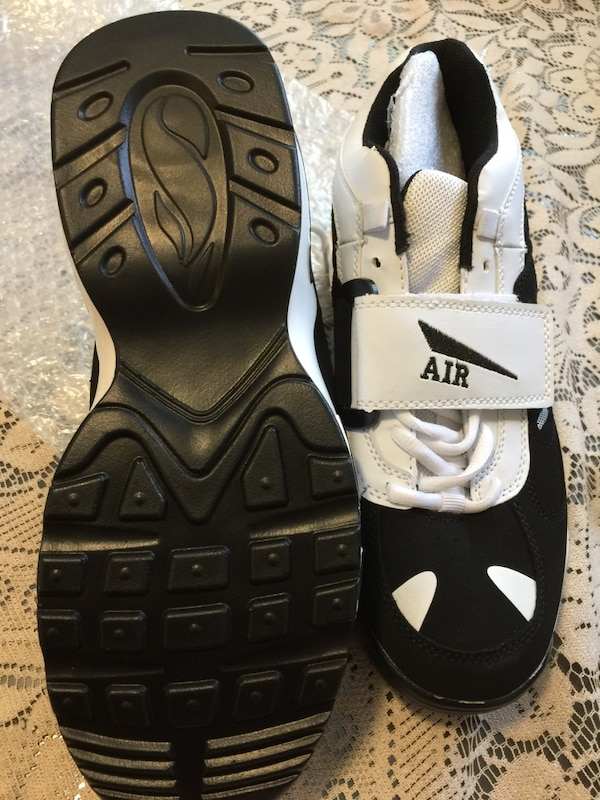 Pair of white-and-black running shoes