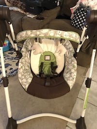 baby's brown, white and green swing chair