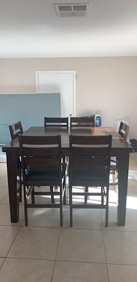 Hardwood 6 chair dining table good condition some scratches chairs in good condition as well  North Las Vegas, 89030