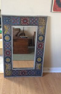 Brown and black wooden framed mirror