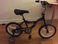 toddler's blue Power X bicycle with training wheels