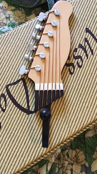 brown and beige guitar headstock Boone, 28607