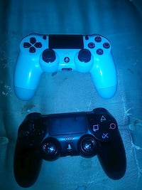 two black and blue Sony PS4 controllers Oakland, 94606