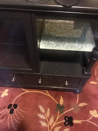 Black wooden tv stand with flat screen television Elyria, 44035