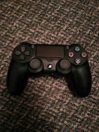 black Sony PS4 wireless controller