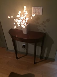 round brown wooden wall table