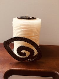 Candle with a metal base.
