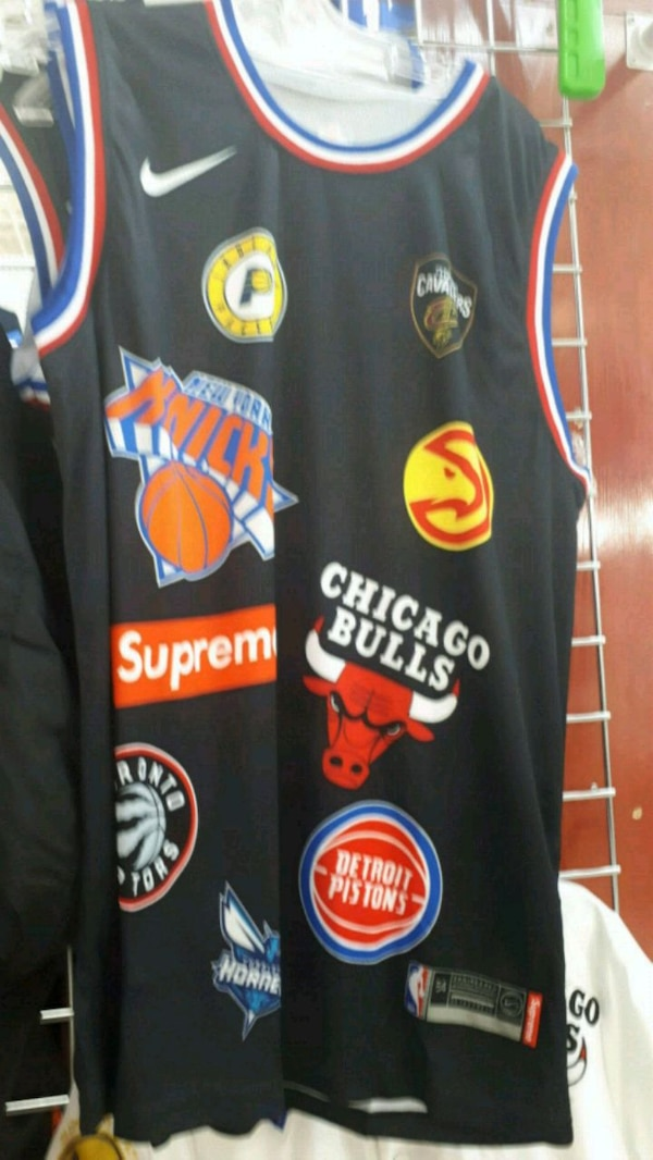 reputable site 788c2 68a26 black and red Chicago Bulls jersey