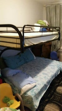 brown wooden bed frame and white mattress 547 km