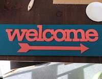 blue and pink wooden Welcome signage Simpsonville, 29680