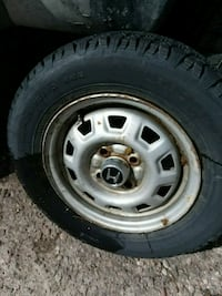 gray 5-spoke car wheel with tire 1784 mi
