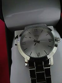 round silver-colored analog watch with link bracel