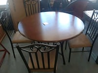 round brown wooden table with four chairs dining set Houston, 77018