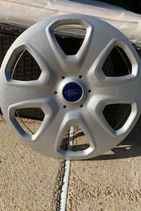 4 Stock Ford Focus hubcaps .