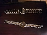 two round silver-colored Movado watches with link bracelets