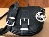 Mini saddle mk crossbody bag. New . no stain or scratches on buckles..Fit the iphone 8 plus New Westminster, V3M