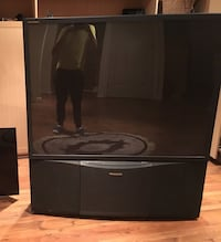 Black flat screen Panasonic TV with black wooden TV stand Richmond Hill, L4C 0G3