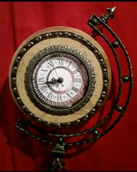 Vintage globe clock with cast iron stand