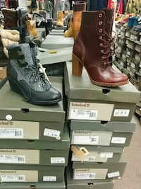 unpaired brown Timberland leather chunky-heeled combat boot and gray-and-black Timberland leather wedge boot with box lot Toronto, M1L 2L6