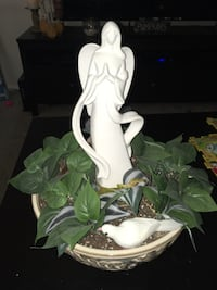 Beautiful flower pot with artificial pants and ceramic angel  Kettering, 45440