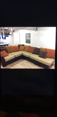 Faux leather and faux microsuede couch.    Vaughan, L6A 1J2