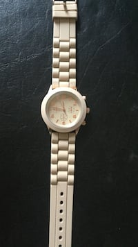 round white framed chronograph watch with white strap