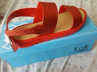 pair of red-and-black sandals Lehigh Acres, 33973