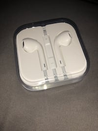 white Apple EarPods in case WASHINGTON