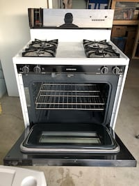 White and black gas range stove. Like new. Kenmore refrigerator in good condition. Door sticks a little but good otherwise   Hawthorne, 90250