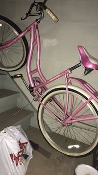 Pink and white cruiser bike