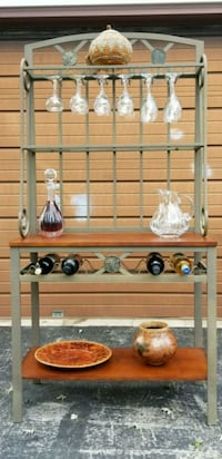 Wrought iron wine rack.  Holds 6 bottles of wine.  Great condition