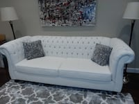 Leather Couch for sale with two grey and white pillows Mississauga, L5N 2R8