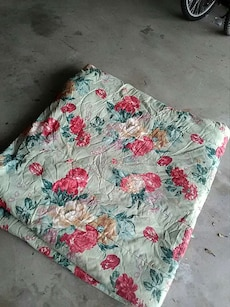 red and green flower print textile
