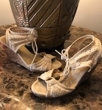 pair of white canvas open-toe wedge sandals