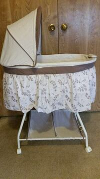 baby's brown and white bassinet Bonsall, 92003
